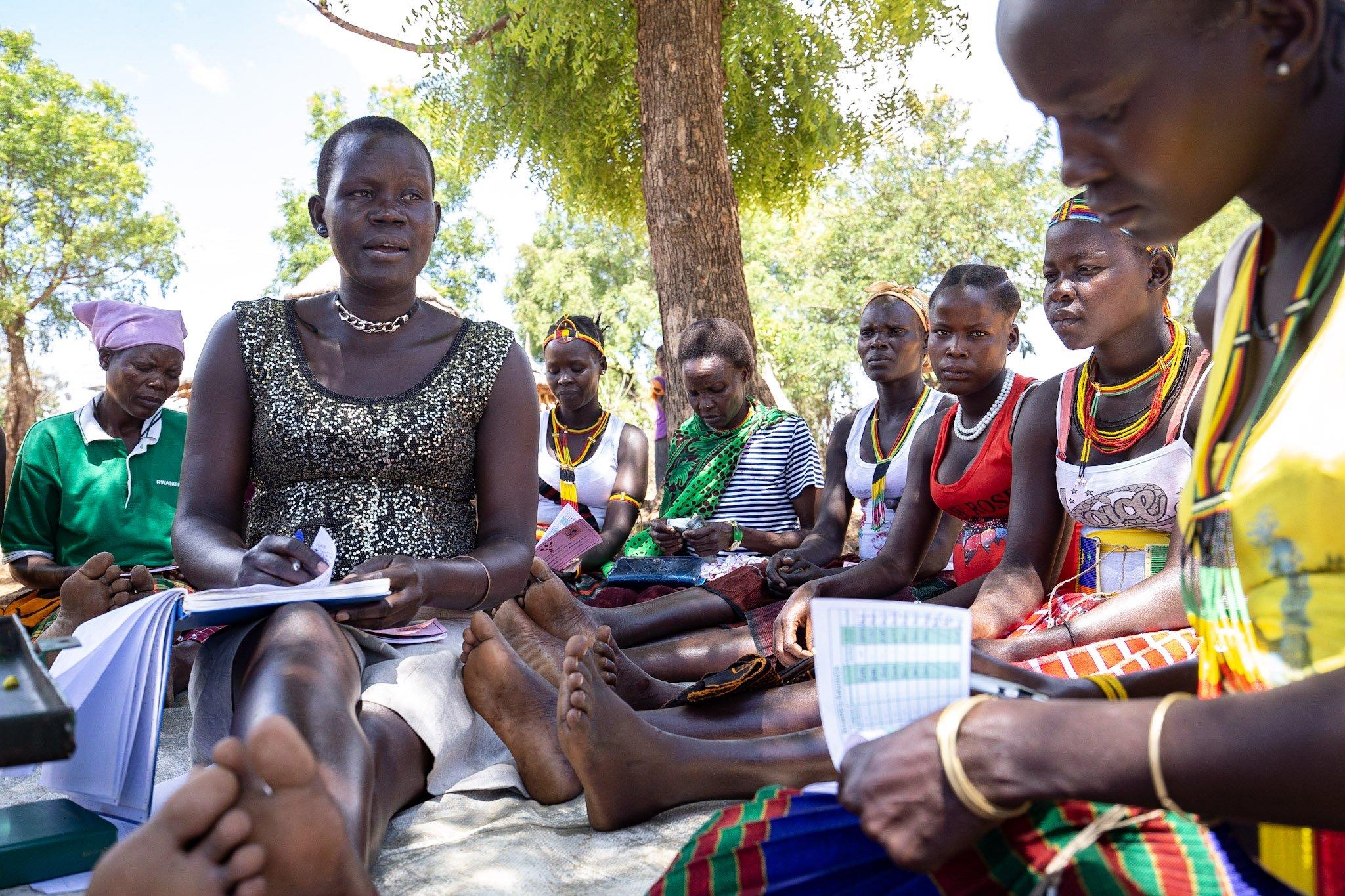 women learning business skills in uganda