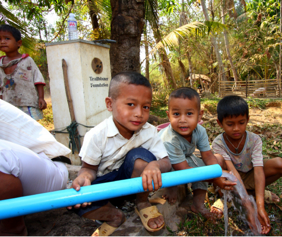 young boys in cambodia with water pipe