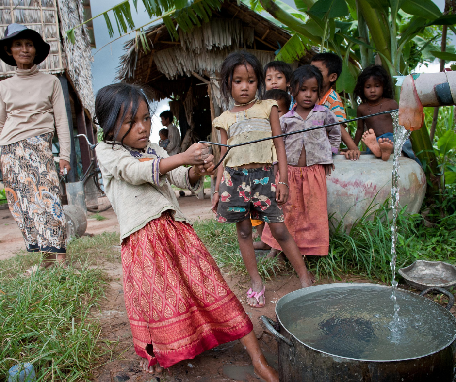 young girl drawing water in cambodia