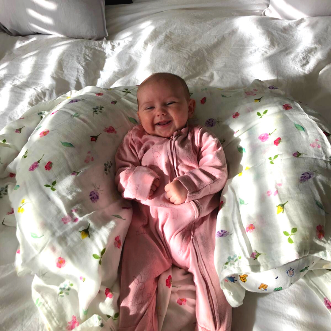 baby girl with meadow spray floral print muslin